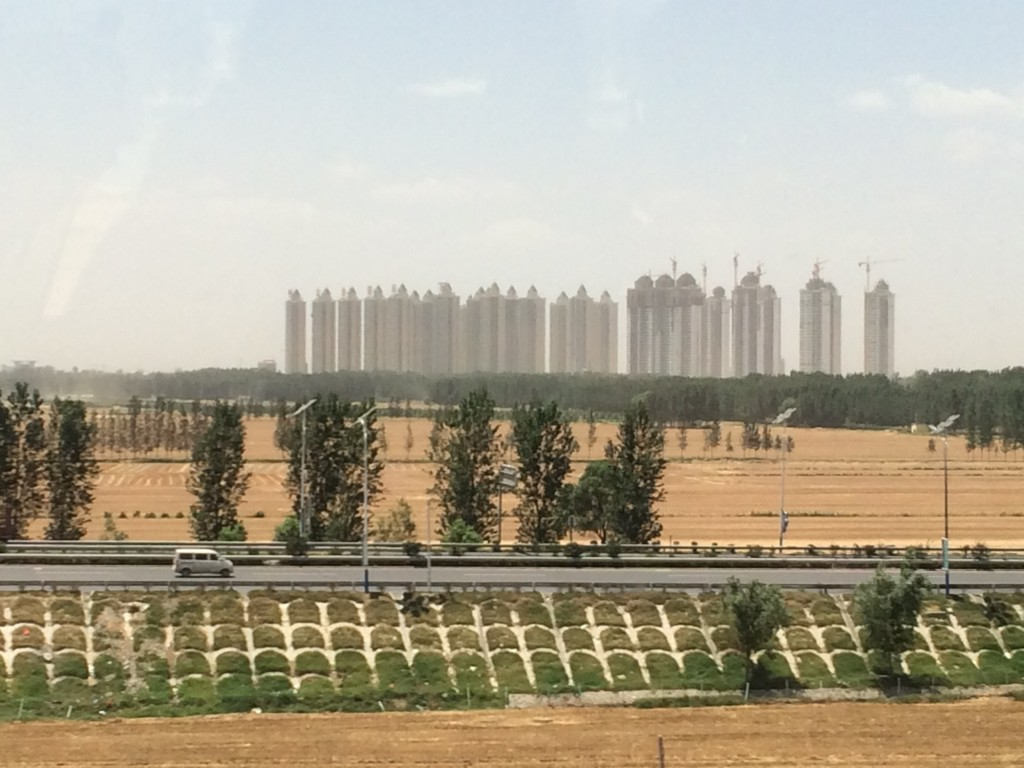 Rows of apartments and/or condos.   In a corn field.  (?)
